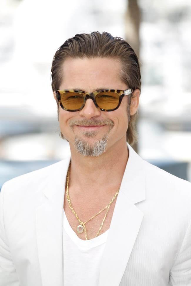 Brad heureux d'être à Cannes. Les photographes? Heureux que Brad soit à Cannes!