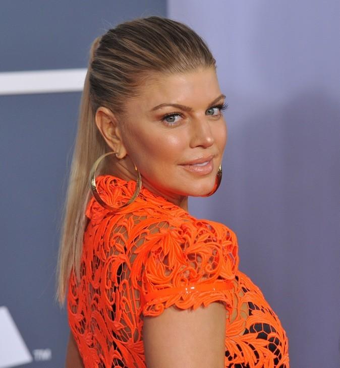 Mention spéciale pour Fergie qui opte pour une queue de cheval relevée par son balayage blond doré.