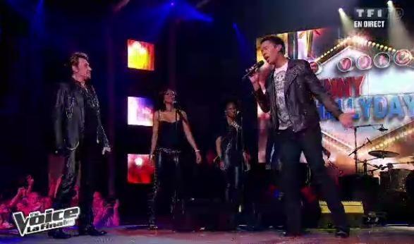 Stéphan Rizon chante avec Johnny Hallyday lors de la finale