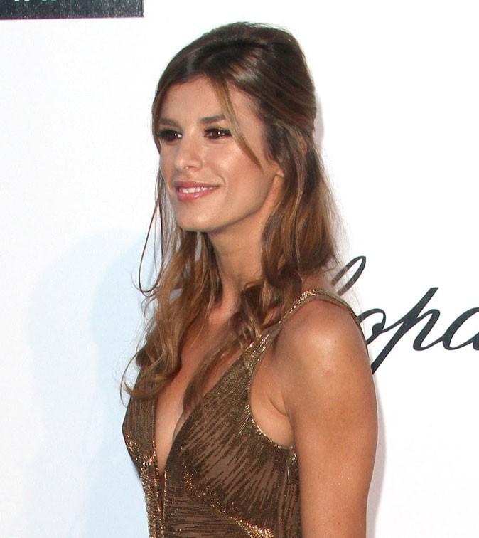 Coiffure de star au Festival de Cannes 2011 : la demi-queue de cheval gonflée d'Elisabetta Canalis
