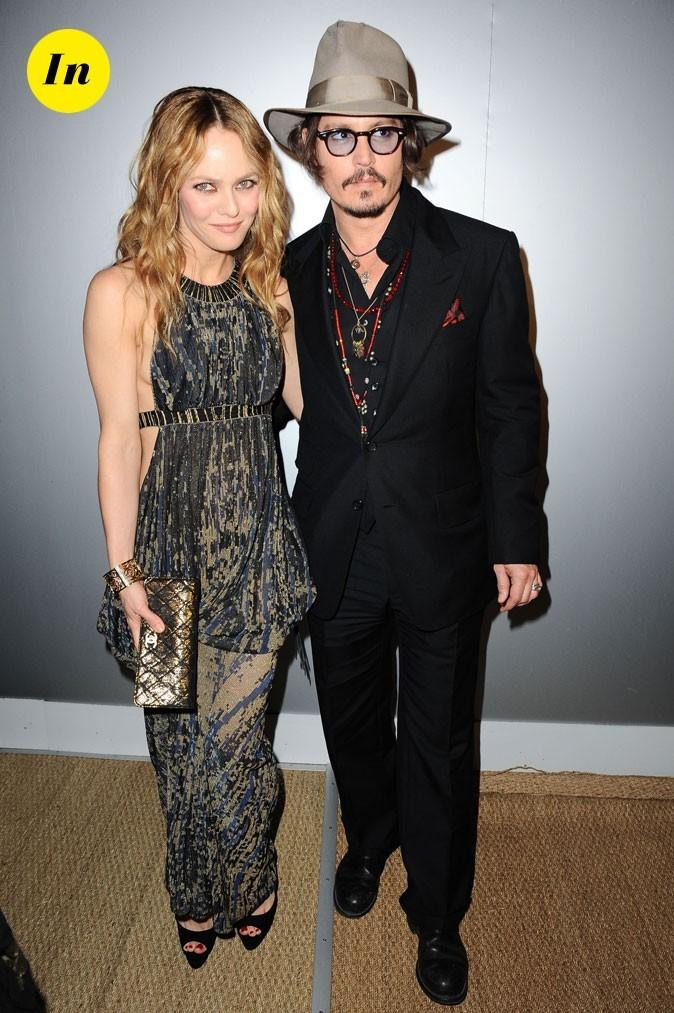 Look de Johnny Depp : costume noir et chapeau en 2010