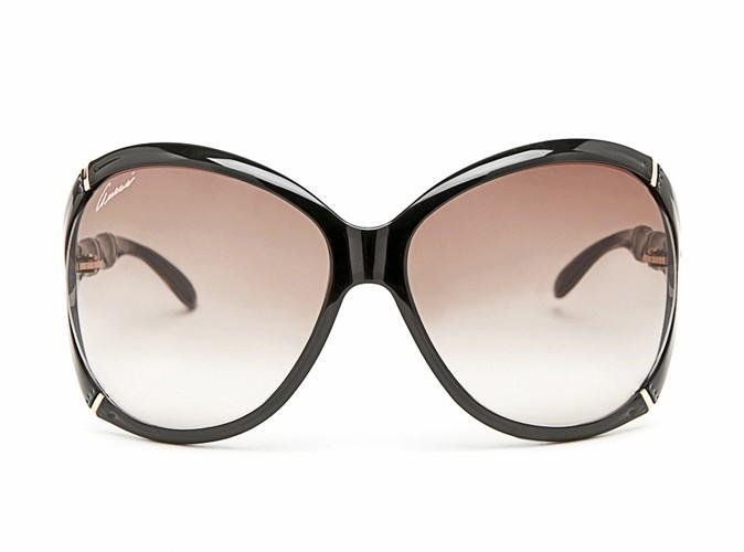 Lunettes de soleil effet masque, Gucci, 252 €.