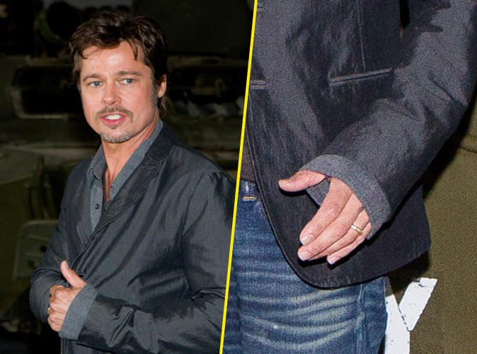 """Brad Pitt fait sa première apparition avec son alliance au doigt lors du photocall de """"Fury"""", le 28 août 2014."""