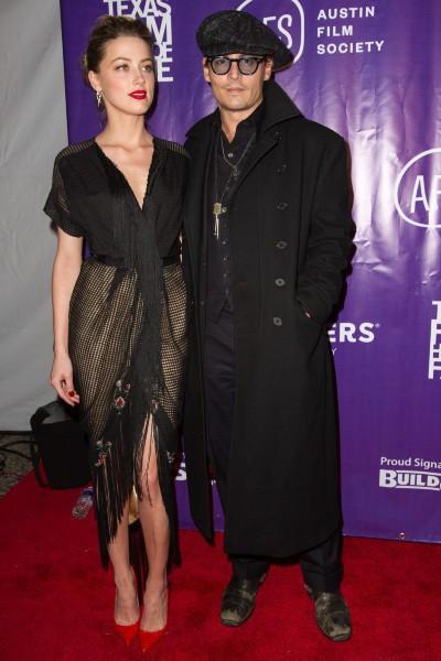 """Amber Heard et Johnny Depp lors de la soirée """"Texas Film Awards"""" à Austin, le 6 mars 2014."""
