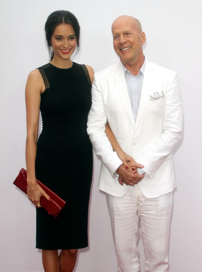 Bruce Willis et Emma Heming lors de la première de Red 2 à Westwood, le 11 juillet 2013.