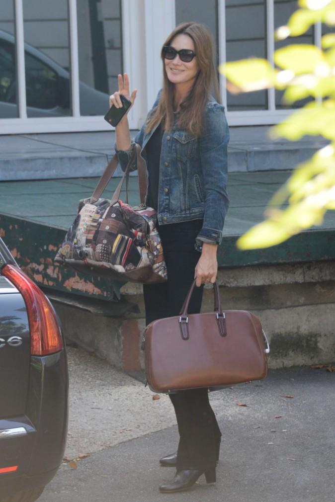 """Carla Bruni à son arrivée devant les studios d'enregistrement de """"Champs-Elysées"""" le 24 septembre 2013"""