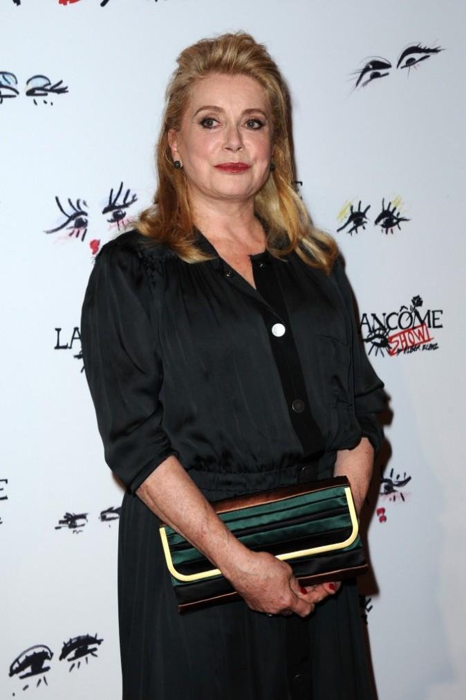 """Catherine Deneuve lors de la soirée """"Lancôme Show by Alber Elbaz"""" à Paris, le 2 juillet 2013."""