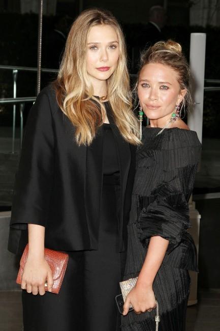Elizabeth et Mary-Kate Olsen lors des CFDA Fashion Awards à New York, le 3 juin 2013.