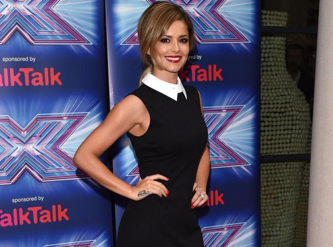 Cheryl Fernandez-Versini : malgré un début de journée difficile, elle s'affiche tout sourire à la conférence de presse X-Factor UK !