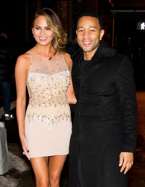 "Chrissy Teigen et son mari John Legend lors de la soirée ""Sports Illustrated"" à New York, le 18 février 2014."