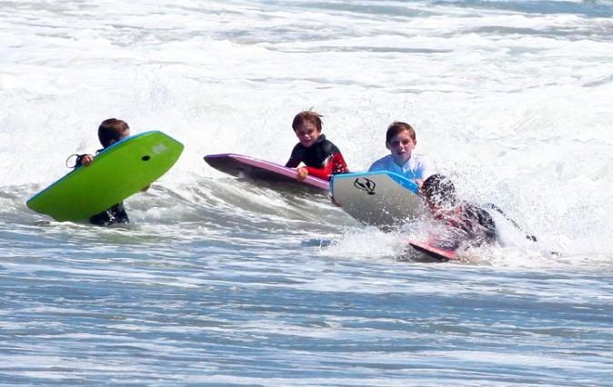 David Beckham et ses fils sur une plage de Malibu, le 31 juillet 2011.