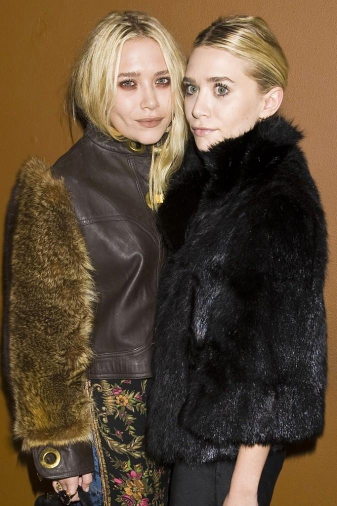 "Mary-Kate et Ashley Olsen lors de l'after-party du film ""Martha Marcy May Marlene"" à New York, le 11 octobre 2011."