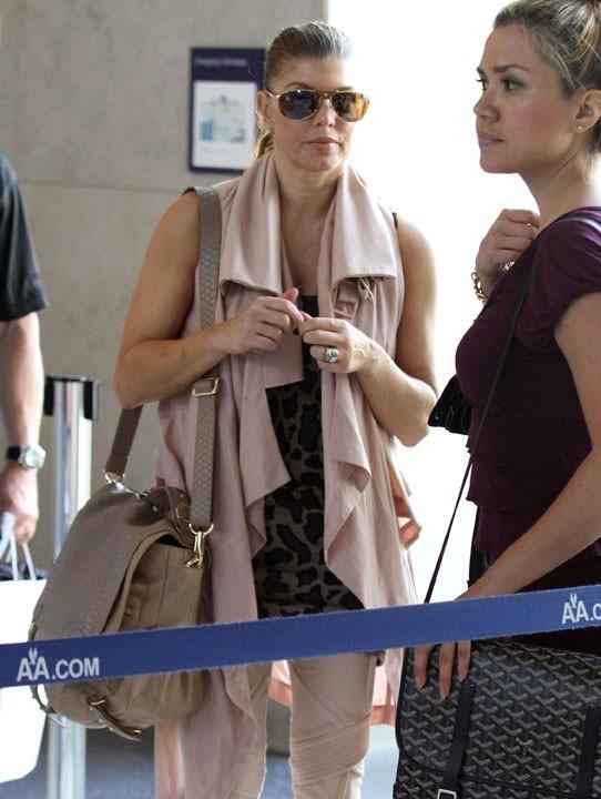 Au départ, Fergie pensait pouvoir embarquer dans l'avion comme une star...