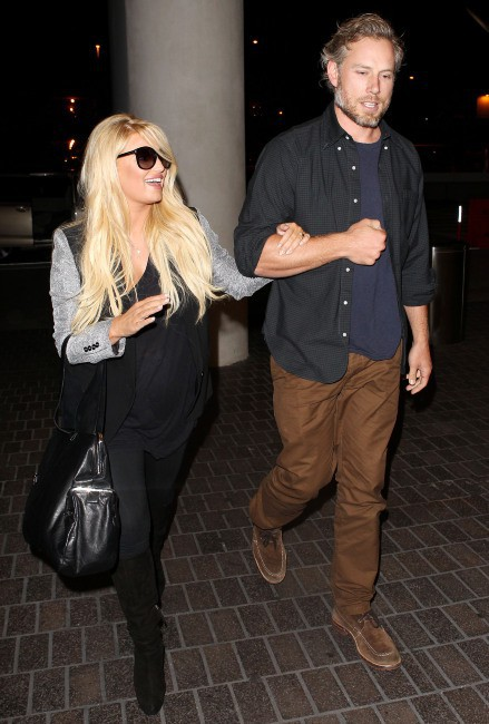 Jessica Simpson et Eric Johnson à l'aéroport de Los Angeles, le 13 octobre 2013.