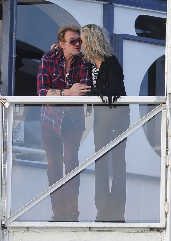 Johnny et Laeticia Hallyday en famille à Santa Monica, le 19 janvier 2014.