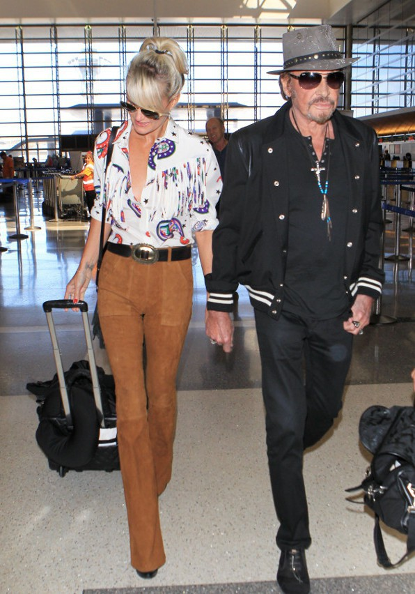 Johnny et Laeticia Hallyday à l'aéroport de Los Angeles le 27 septembre 2015