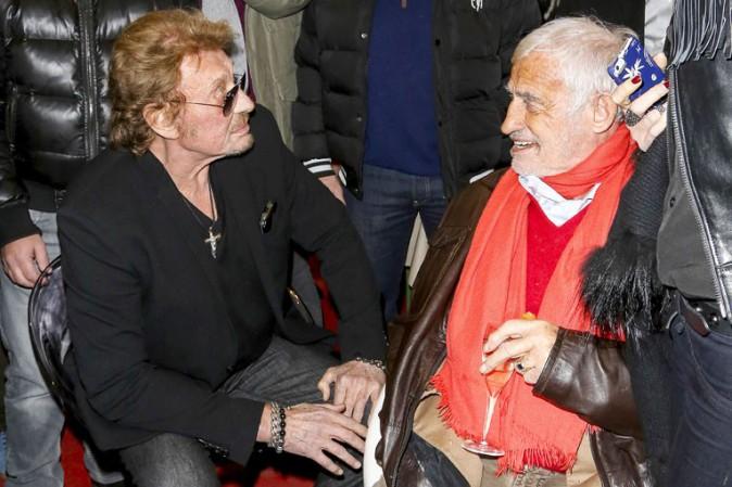 """Johnny Hallyday et Jean-Paul Belmondo à l'inauguration de """"Jours de fête"""" au Grand Palais, à Paris, le 19 décembre 2013"""
