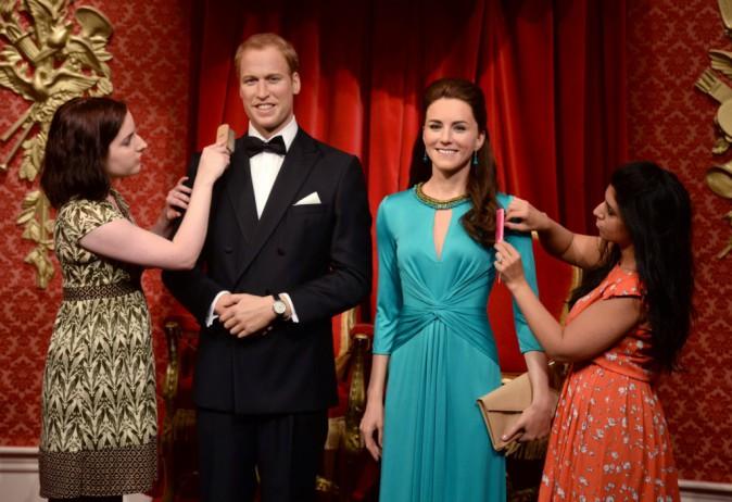 Les mannequins de cire représentant le duc et la duchesse de Cambridge installés au Musée Tussauds à Londres, le 2 juillet 2014