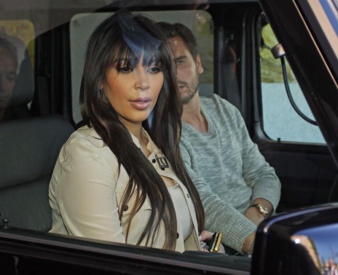 Kim Kardashian à Sherman Oaks avec son beau-frère Scott Disick, le 4 avril 2013.