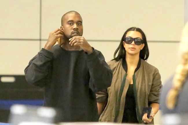 Kim Kardashian et Kanye West à l'aéroport de Los Angeles le 2 août 2014