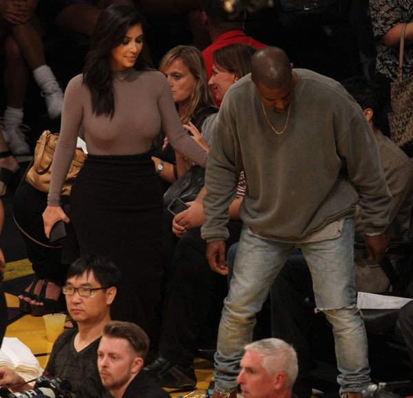 Kim Kardashian et Kanye West au Staples Center de Los Angeles le 28 octobre 2014