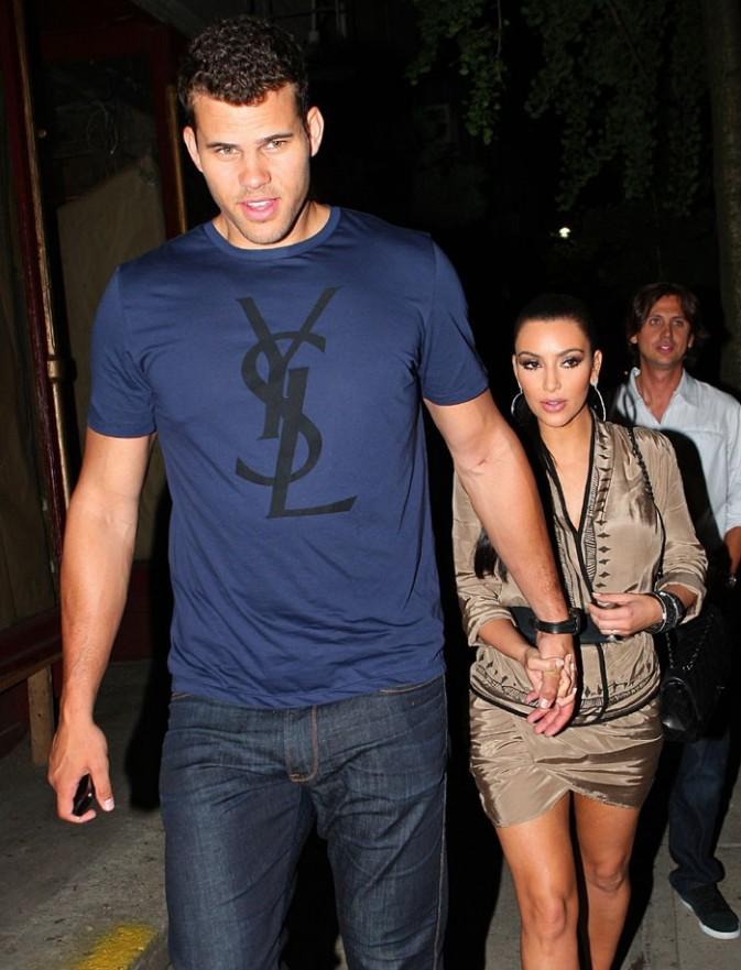 Kim s'est trouvé un garde du coprs de taille !
