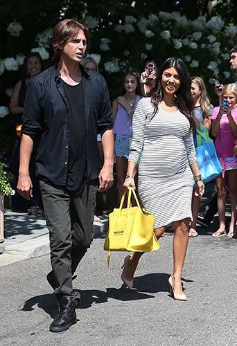 Kourtney Kardashian et Jonathan Cheban à Southampton le 14 août 2014