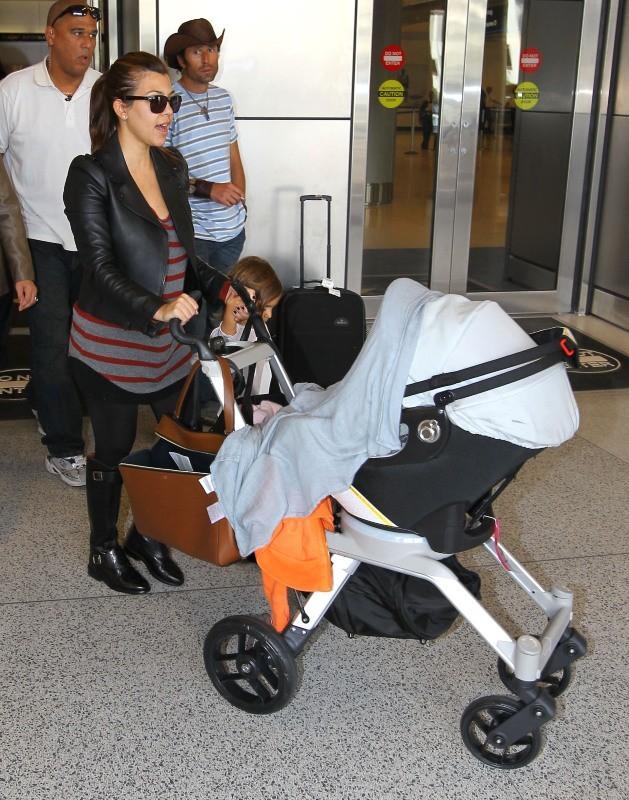 Kourtney Kardashian de retour en famille à Miami, le 14 novembre 2012.