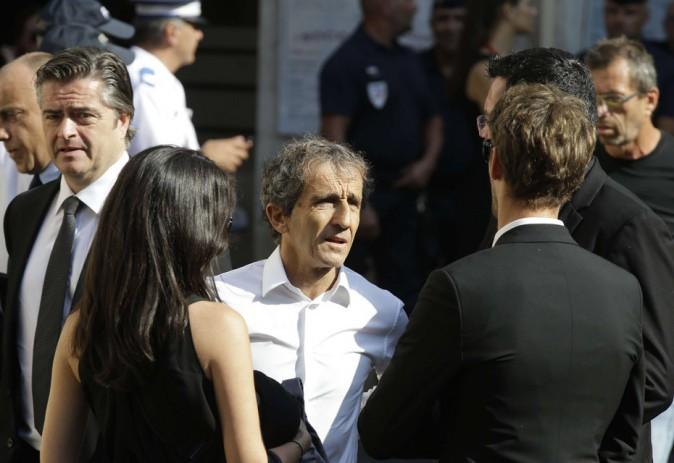 Alain Prost avec Marion Jolles et Romain Grosjean (de dos)