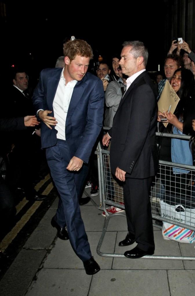 Le prince Harry se rendant à la première du film The Dark Knight Rises à Londres, le 18 juillet 2012.