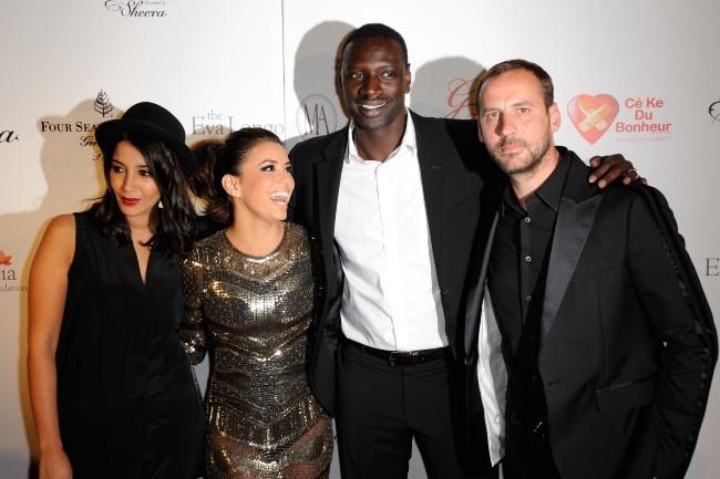 Leïla Bekhti, Eva Longoria, Omar Sy et Fred Testot lors du Global Gift Gala à Paris, le 28 mai 2012.