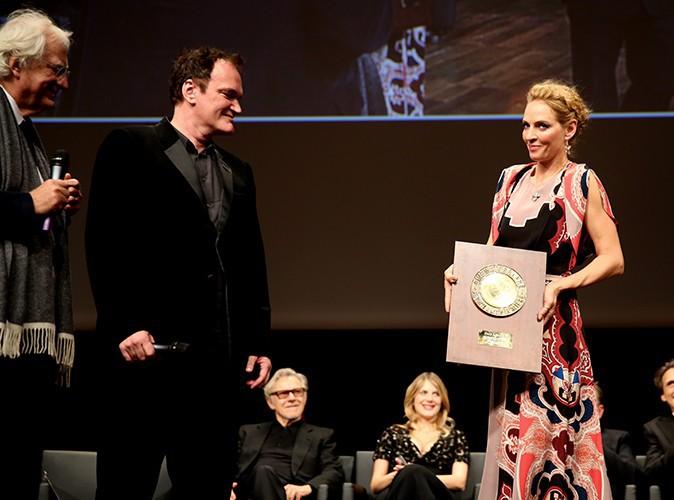 Quentin Tarantino reçoit son prix Lumière des mains d'Uma Thurman à Lyon le 18 octobre 2013