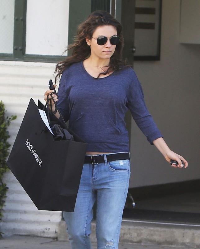 Mila Kunis à Beverly Hills, le 26 mars 2014.