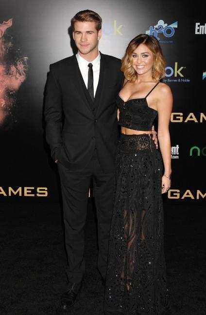 Miley Cyrus et Liam Hemsworth lors de la première du film Hunger Games à Los Angeles, le 12 mars 2012.