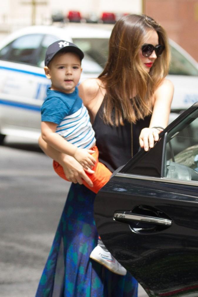 Miranda Kerr et son fils Flynn à New York, le 13 juillet 2013.