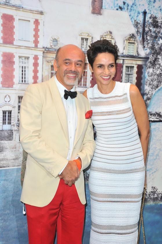 Chritsitan Louboutin et Farida Khelfa lors de la soirée White Fairy Tale Love Ball à Paris, le 6 juillet 2011.
