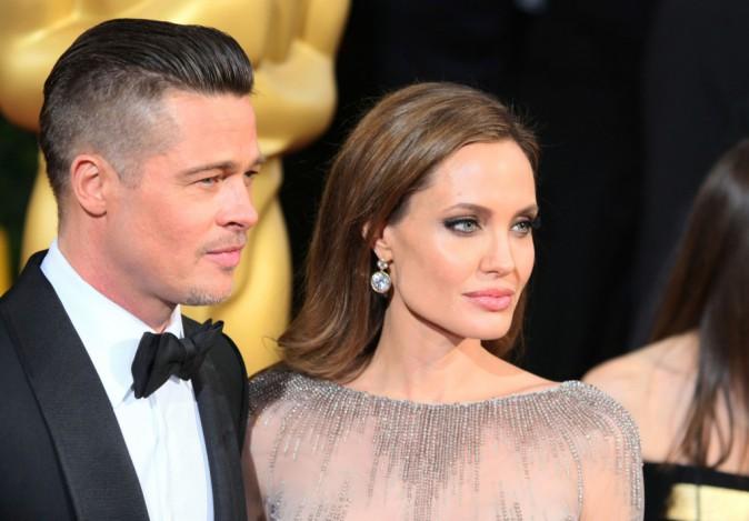 Brad Pitt et Angelina Jolie lors de la 86e cérémonie des Oscars à Hollywood, le 2 mars 2014.