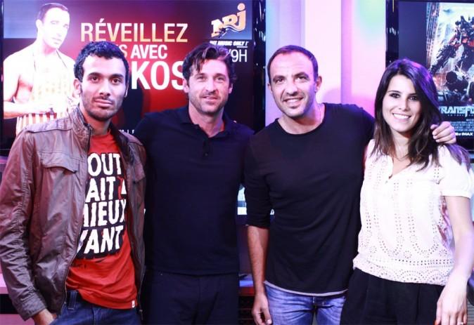 Patrick Dempsey chez NRJ, aux côté de Nikos, Karine et Mustapha, le 27 juin 2011.