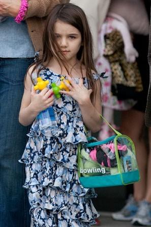 Une petit fille qui adore les jouets !
