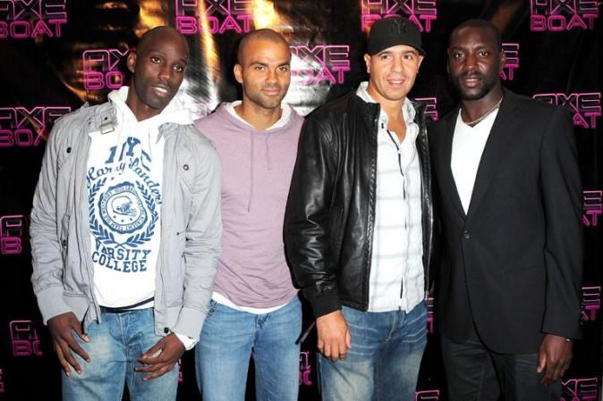 Leslie Djhone, Tony Parker, Cut Killer et Ladji Doucoure lors de la soirée Axe Boat Tour 2011 à Paris, le 16 juillet 2011.