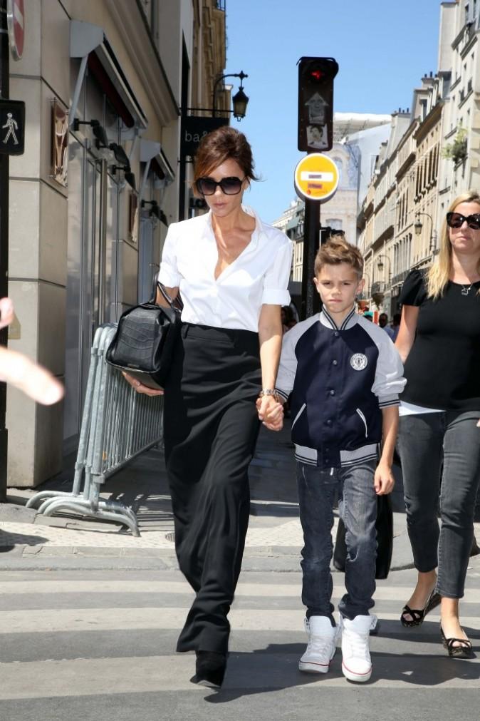 Victoria Beckham et son fils Romeo, Paris, le 23 juillet 2012