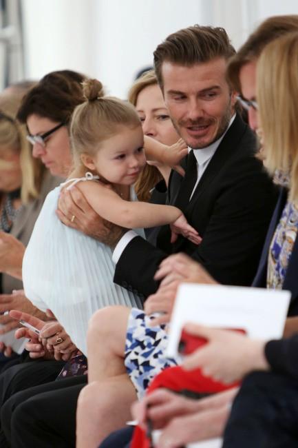 David et Harper Beckham du défilé Victoria Beckham à New York, le 8 septembre 2013.