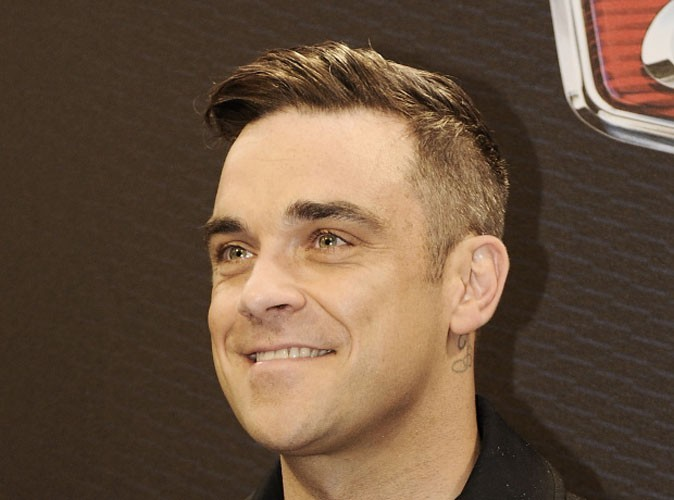 Robbie Williams : c'est une fille... et elle fera de la boxe et du karaté !